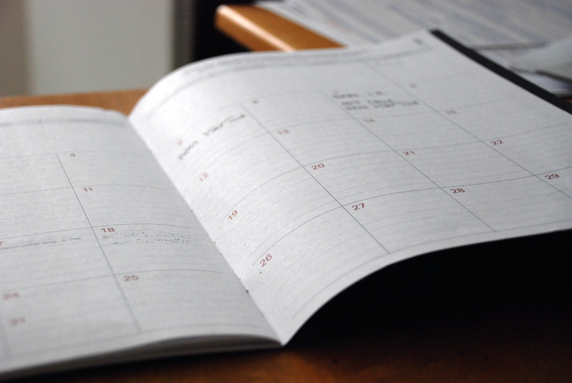 A close-up of slightly out-of-focus monthly planner printed on a white paper.